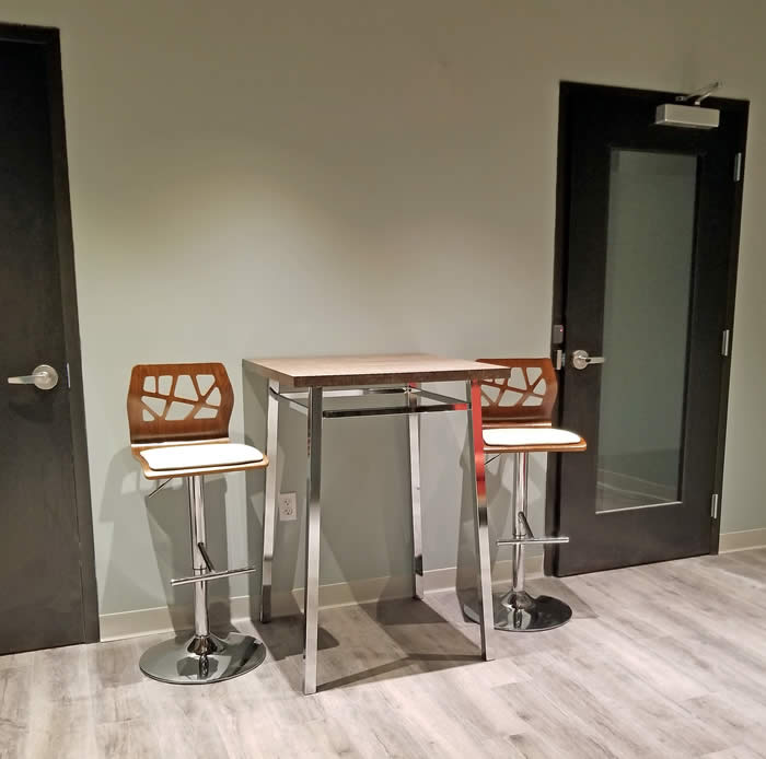 Urgent Care wellness center cool waiting room cafe table and stools