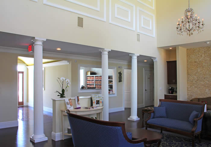 Plastic & Reconstructive Surgery Center Classic waiting area with high ceiling and chandeliers