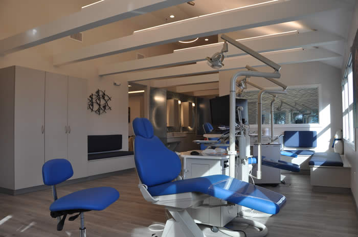 Kelly Family Orthodontics ortho bay with blue chairs and 3form glass