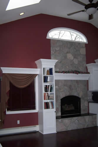 custom fireplace, mantle bookcase & cornice over window treatment