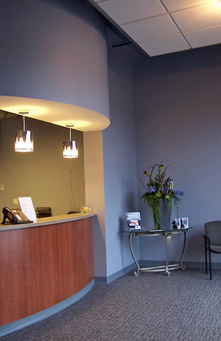 Mega Mechanical reception desk with cool pendant lighting