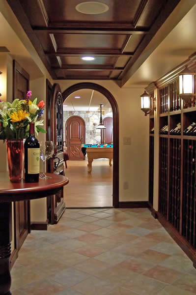 arch doors and stone walls of wine cellar game room