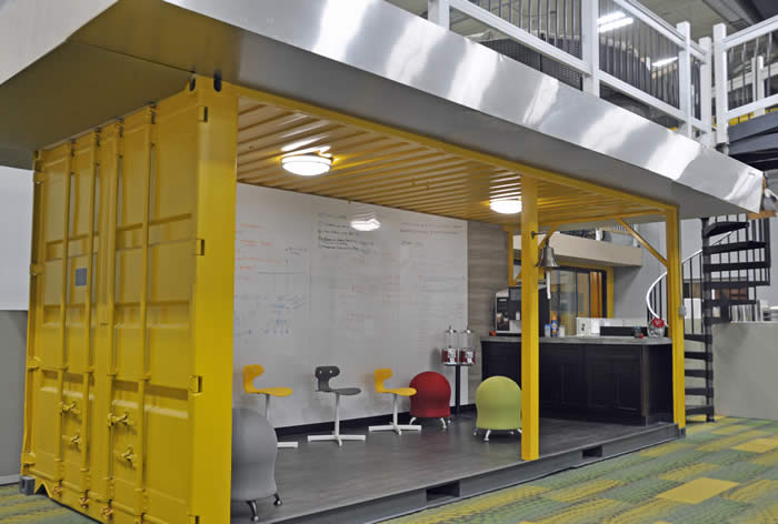 Express Kitchen corporate headquarters with cool shipping containers for employee interative areas