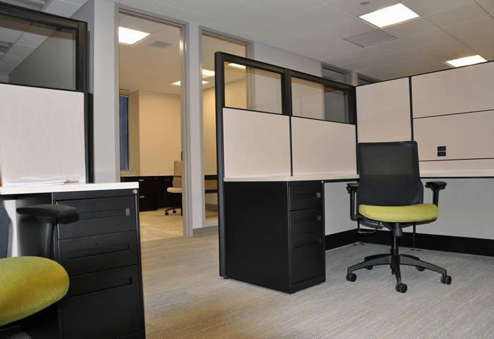 Business Lenders workstations and task chairs with pop of green